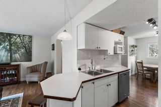 Photo 6: 102 4810 40 Avenue SW in Calgary: Glamorgan Row/Townhouse for sale : MLS®# A1136264