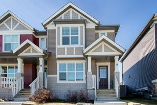 Photo 1: 64 Sunvalley Road: Cochrane Row/Townhouse for sale : MLS®# A1108247
