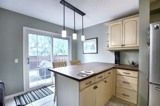 Photo 9: 373 Point Mckay Gardens NW in Calgary: Point McKay Row/Townhouse for sale : MLS®# A1063969