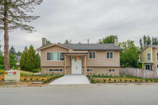 """Photo 1: 5059 199A Street in Surrey: Langley City House for sale in """"Nicomekl river"""" (Langley)  : MLS®# R2611778"""
