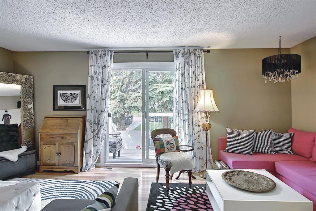 Main Photo: 11436 8 Street SW in Calgary: Southwood Row/Townhouse for sale : MLS®# A1130465