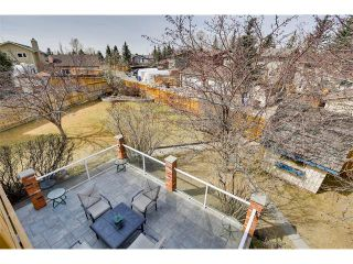 Photo 2: 27 COACHWOOD Place SW in Calgary: Coach Hill House for sale