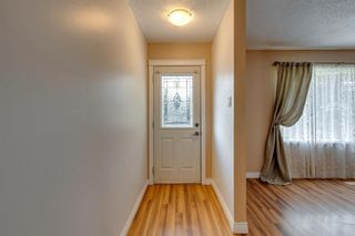 Photo 2: 302 Whitney Crescent SE in Calgary: Willow Park Detached for sale : MLS®# A1146432