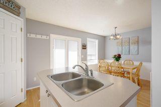 Photo 10: 136 Hidden Hills Road NW in Calgary: Hidden Valley Detached for sale : MLS®# A1094524