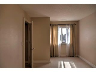 Photo 15: 248 54 GLAMIS Green SW in Calgary: Glamorgan House for sale : MLS®# C4109785