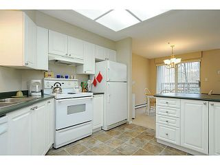 """Photo 5: 110 2551 PARKVIEW Lane in Port Coquitlam: Central Pt Coquitlam Condo for sale in """"THE CRESCENT"""" : MLS®# V1041287"""