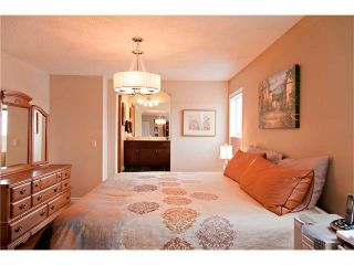 Photo 19: 48 COUGARSTONE Court SW in Calgary: Cougar Ridge House for sale : MLS®# C4045394