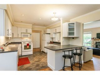 """Photo 7: 1427 160A Street in Surrey: King George Corridor House for sale in """"Ocean Village"""" (South Surrey White Rock)  : MLS®# R2453736"""