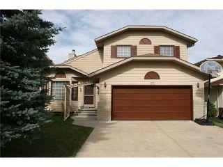 Photo 1: 93 SUNDOWN Close SE in CALGARY: Sundance Residential Detached Single Family for sale (Calgary)  : MLS®# C3494208