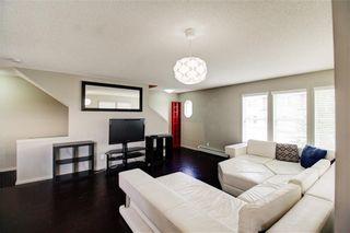Photo 8: 50 Auburn Bay Common SE in Calgary: Auburn Bay Row/Townhouse for sale : MLS®# A1128928