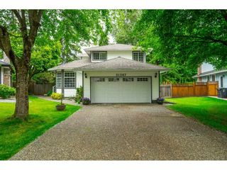 """Photo 1: 21387 87B Avenue in Langley: Walnut Grove House for sale in """"Forest Hills"""" : MLS®# R2585075"""