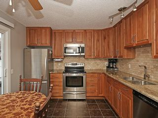 Photo 4: 121 999 CANYON MEADOWS Drive SW in Calgary: Canyon Meadows House for sale : MLS®# C4113761