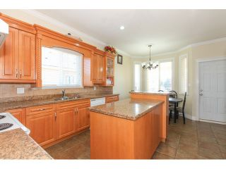 Photo 9: 12550 89A Avenue in Surrey: Queen Mary Park Surrey House for sale : MLS®# F1438329