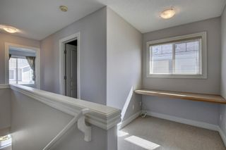 Photo 23: 76 Bridleridge Manor SW in Calgary: Bridlewood Row/Townhouse for sale : MLS®# A1106883