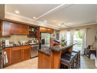 "Photo 12: 8 4839 CENTRAL Avenue in Delta: Hawthorne Townhouse for sale in ""Parkside Estates"" (Ladner)  : MLS®# R2580180"