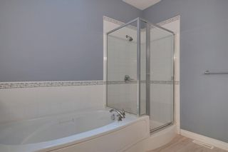 Photo 18: 212 SIMCOE Place SW in Calgary: Signal Hill Semi Detached for sale : MLS®# C4293353