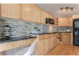 Photo 15: 69 STRATHLEA Place SW in Calgary: Strathcona Park House for sale : MLS®# C4101174