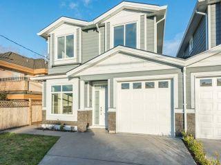 Photo 1: 6486 BRANTFORD Avenue in Burnaby: Upper Deer Lake 1/2 Duplex for sale (Burnaby South)  : MLS®# R2187635