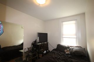 """Photo 6: 1656 E 4TH Avenue in Vancouver: Grandview VE Fourplex for sale in """"Commercial Drive"""" (Vancouver East)  : MLS®# R2195268"""