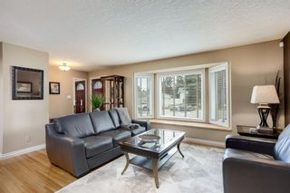 Photo 2: 308 99 Avenue SE in Calgary: Willow Park Detached for sale : MLS®# A1111736