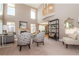 Photo 4: 69 STRATHLEA Place SW in Calgary: Strathcona Park House for sale : MLS®# C4101174