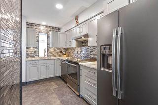 "Photo 4: 104 1570 PRAIRIE Avenue in Port Coquitlam: Glenwood PQ Townhouse for sale in ""Violas"" : MLS®# R2567923"