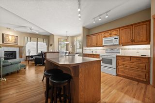 Photo 4: 8 Tuscany Village Court NW in Calgary: Tuscany Semi Detached for sale : MLS®# A1130047