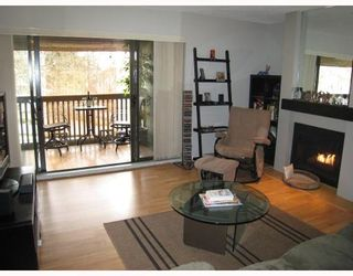 Photo 1: 311 7055 WILMA Street in The Beresford: Home for sale