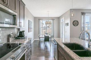 Photo 10: 203 Boulder Creek Bay SE: Langdon Detached for sale : MLS®# A1149788