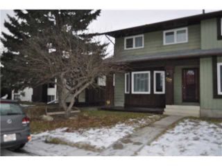 Photo 1: 557 SUMMERWOOD Place SE: Airdrie Residential Attached for sale : MLS®# C3592604