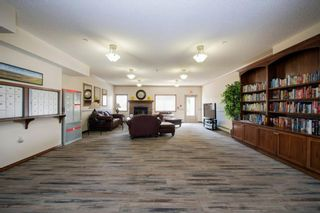 Photo 17: 101 72 Quigley Drive: Cochrane Apartment for sale : MLS®# A1091486