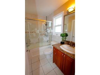 Photo 18: 8075 135A Street in Surrey: Queen Mary Park Surrey House for sale : MLS®# F1444482