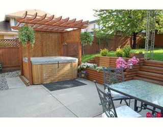 """Photo 6: 6828 181ST Street in Surrey: Cloverdale BC House for sale in """"Cloverwoods"""" (Cloverdale)  : MLS®# F2711956"""