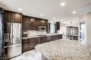 Photo 1: 335 Woodpark Place SW in Calgary: Woodlands Detached for sale : MLS®# A1110869