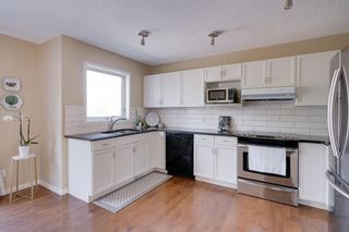 Photo 11: 18 Stradwick Rise SW in Calgary: Strathcona Park Semi Detached for sale : MLS®# A1125011