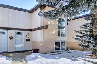 Main Photo: 140 Oaktree Lane SW in Calgary: Oakridge Row/Townhouse for sale : MLS®# A1068739