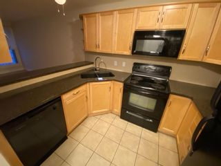 Photo 5: 147 54 Glamis Green SW in Calgary: Glamorgan Row/Townhouse for sale : MLS®# A1076513