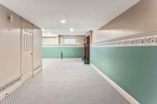 Photo 13: 51 SANDRINGHAM Way NW in Calgary: Sandstone Valley House for sale
