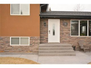 Photo 2: 34 GLENPATRICK Place: Cochrane House for sale : MLS®# C4055156