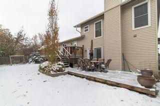 Photo 28: 319 Woodside Place: Okotoks Detached for sale : MLS®# A1044148