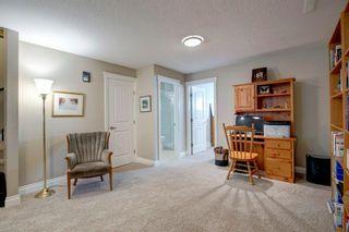 Photo 26: 340 Quarry Park Boulevard SE in Calgary: Douglasdale/Glen Row/Townhouse for sale : MLS®# A1123884