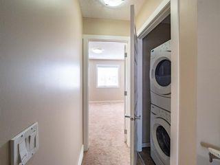 Photo 17: 70 Auburn Bay Link SE in Calgary: Auburn Bay Row/Townhouse for sale : MLS®# A1102367