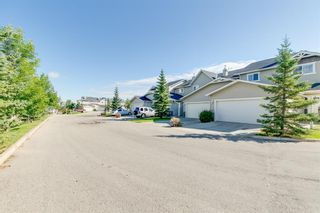 Photo 4: 58 Arbours Circle NW: Langdon Row/Townhouse for sale : MLS®# A1137898