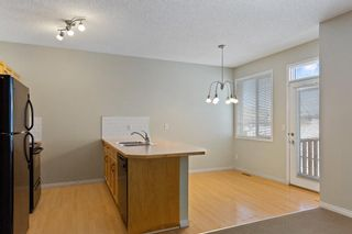 Photo 12: 94 Everridge Gardens SW in Calgary: Evergreen Row/Townhouse for sale : MLS®# A1069502