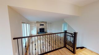 Photo 7: 94 Sunset Way SE in Calgary: Sundance Detached for sale : MLS®# A1136113