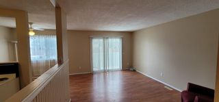Photo 3: E 1215 44 Street SE in Calgary: Forest Lawn Row/Townhouse for sale : MLS®# A1104267