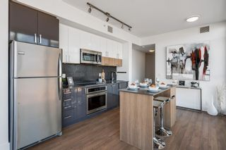 Photo 9: 412 619 Confluence Way SE in Calgary: Downtown East Village Apartment for sale : MLS®# A1118938
