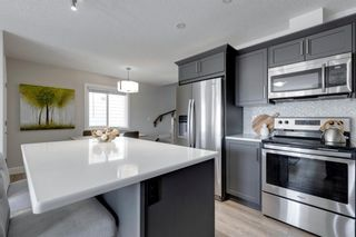Photo 11: 144 Yorkville Avenue SW in Calgary: Yorkville Row/Townhouse for sale : MLS®# A1145393