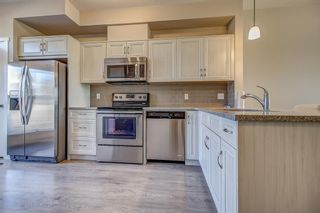 Photo 6: 100 Legacy Main Street SE in Calgary: Legacy Row/Townhouse for sale : MLS®# A1095155
