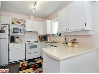 """Photo 2: 1 6537 138TH Street in Surrey: East Newton Townhouse for sale in """"CHARLESTON GREEN"""" : MLS®# F1006130"""
